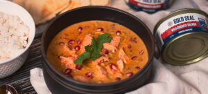 A bowl of Salmon in Pomegranate Curry