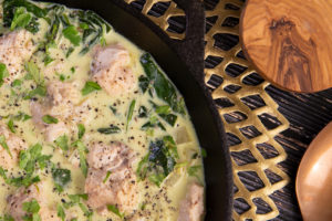 A pan of Spinach, Fennel and Coconut Milk Salmon