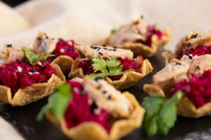A group of plated Mackerel Nacho Bites with Horseradish Beet Puree